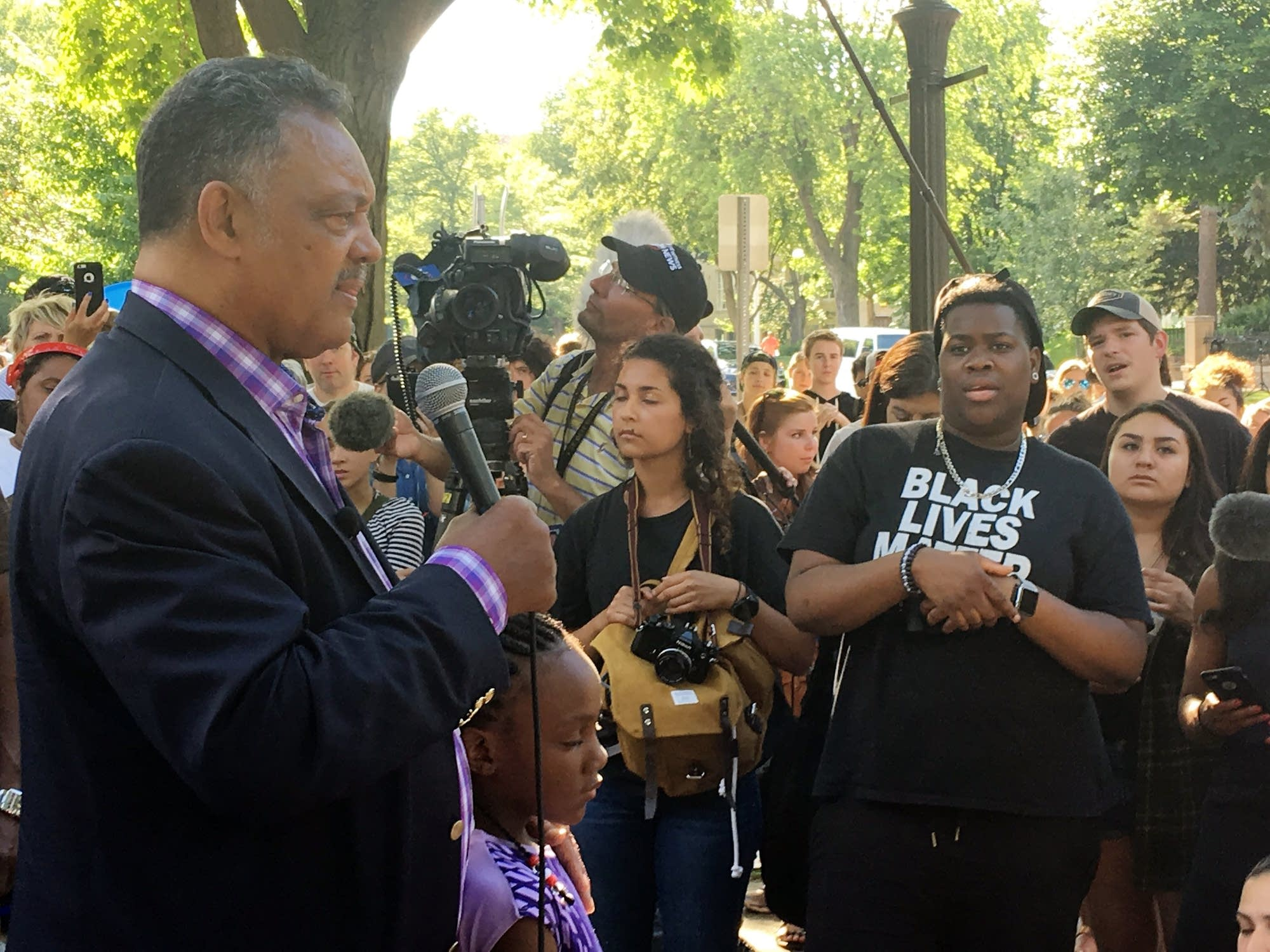 The Rev. Jesse Jackson speaks with protesters.