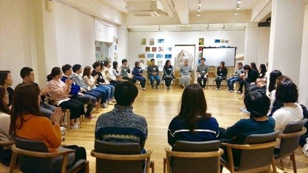 Haemin Sunim leads a session at the School of Heart in Seoul, South Korea.