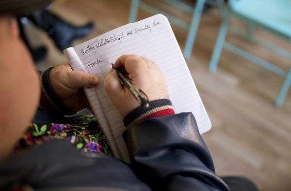A student takes notes in Katy Park's Relate class.