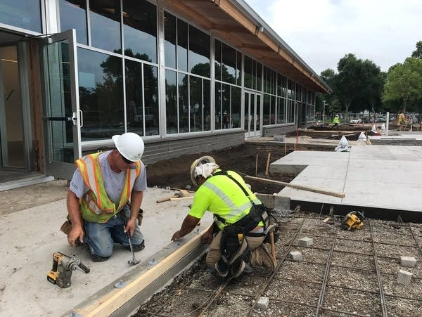 Construction workers prepare for the opening of the North End Event Center