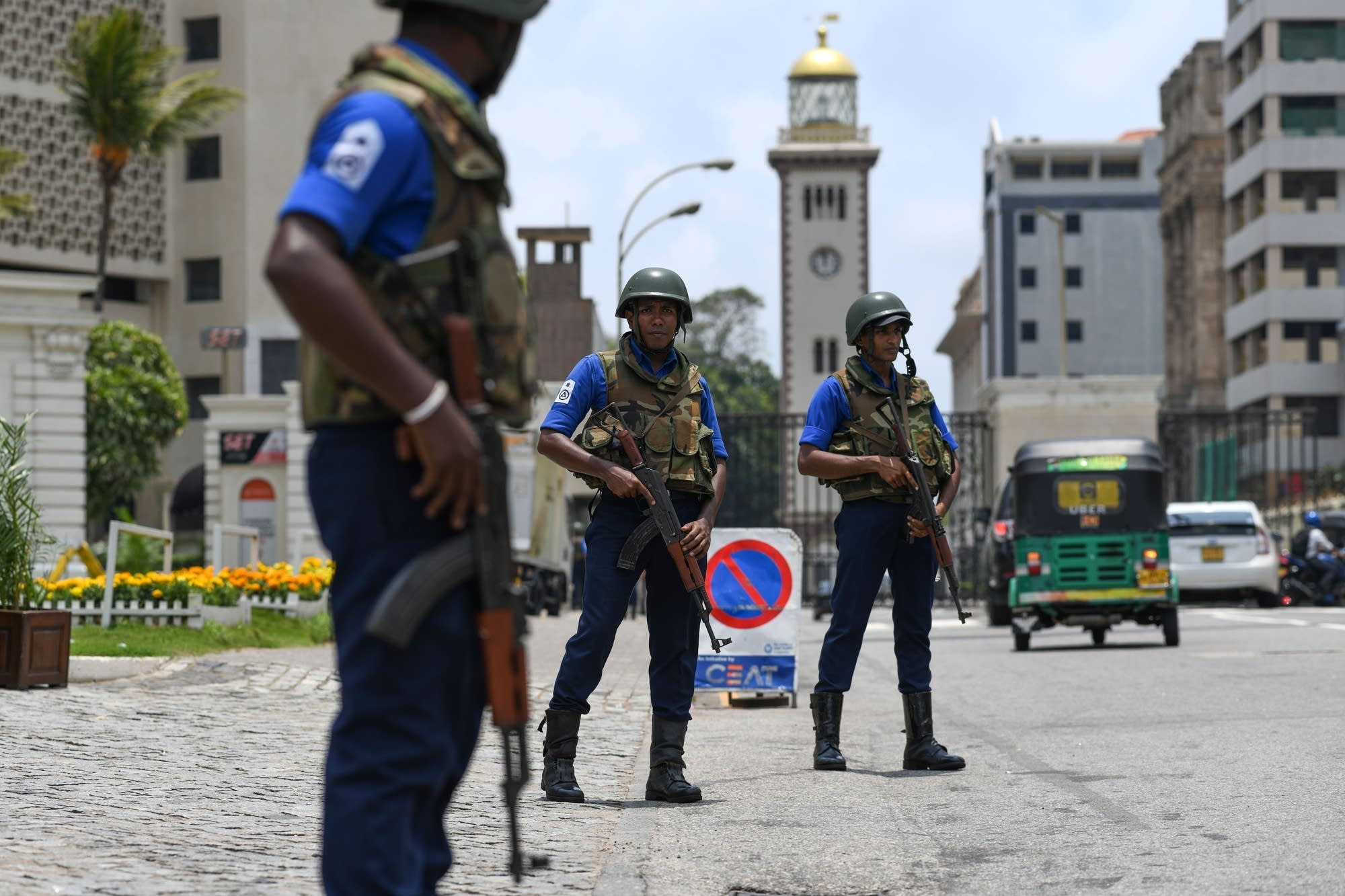 Soldiers take up their positions at a checkpoint on a street in Colombo.