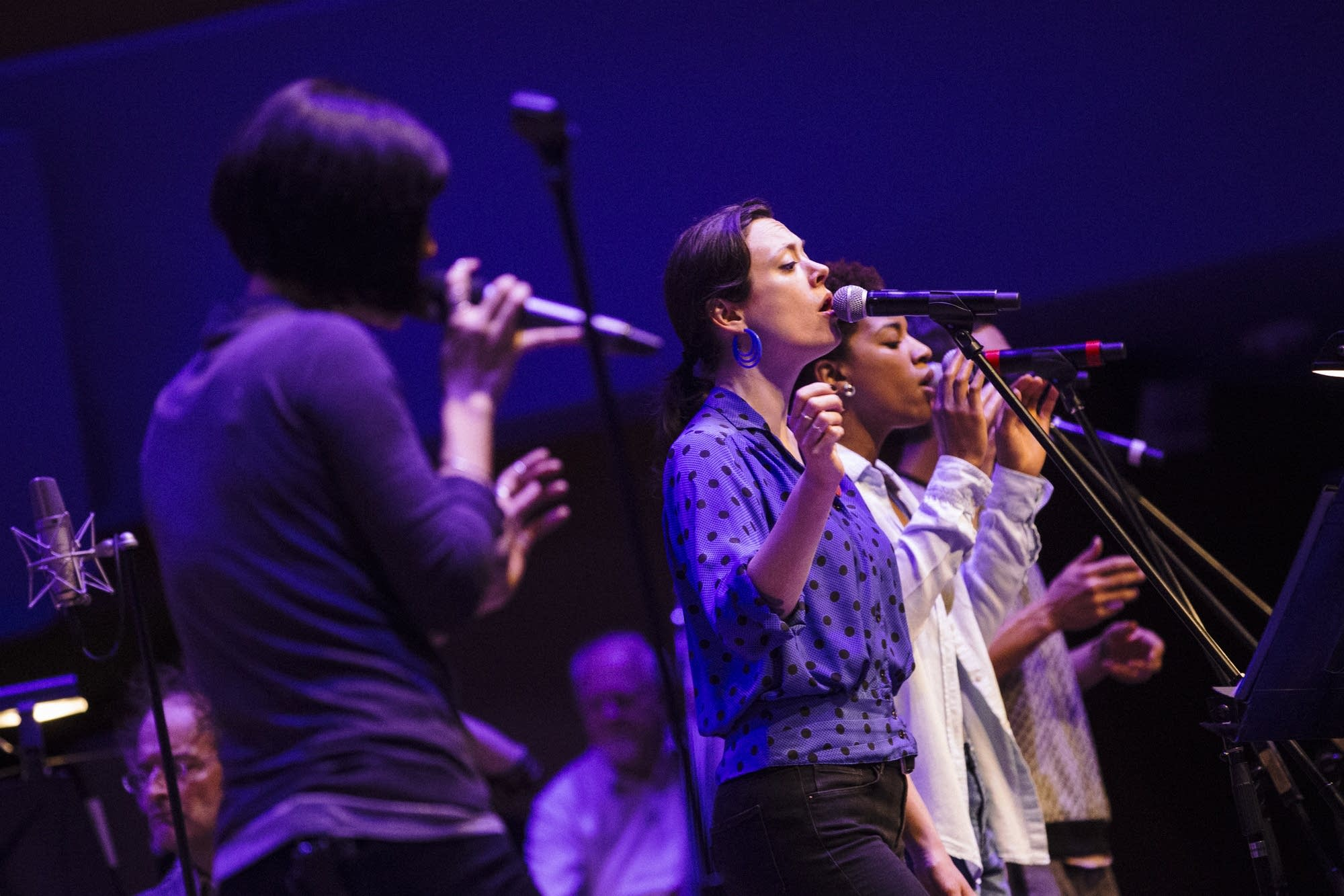 Backup singers rehearse with Dessa.