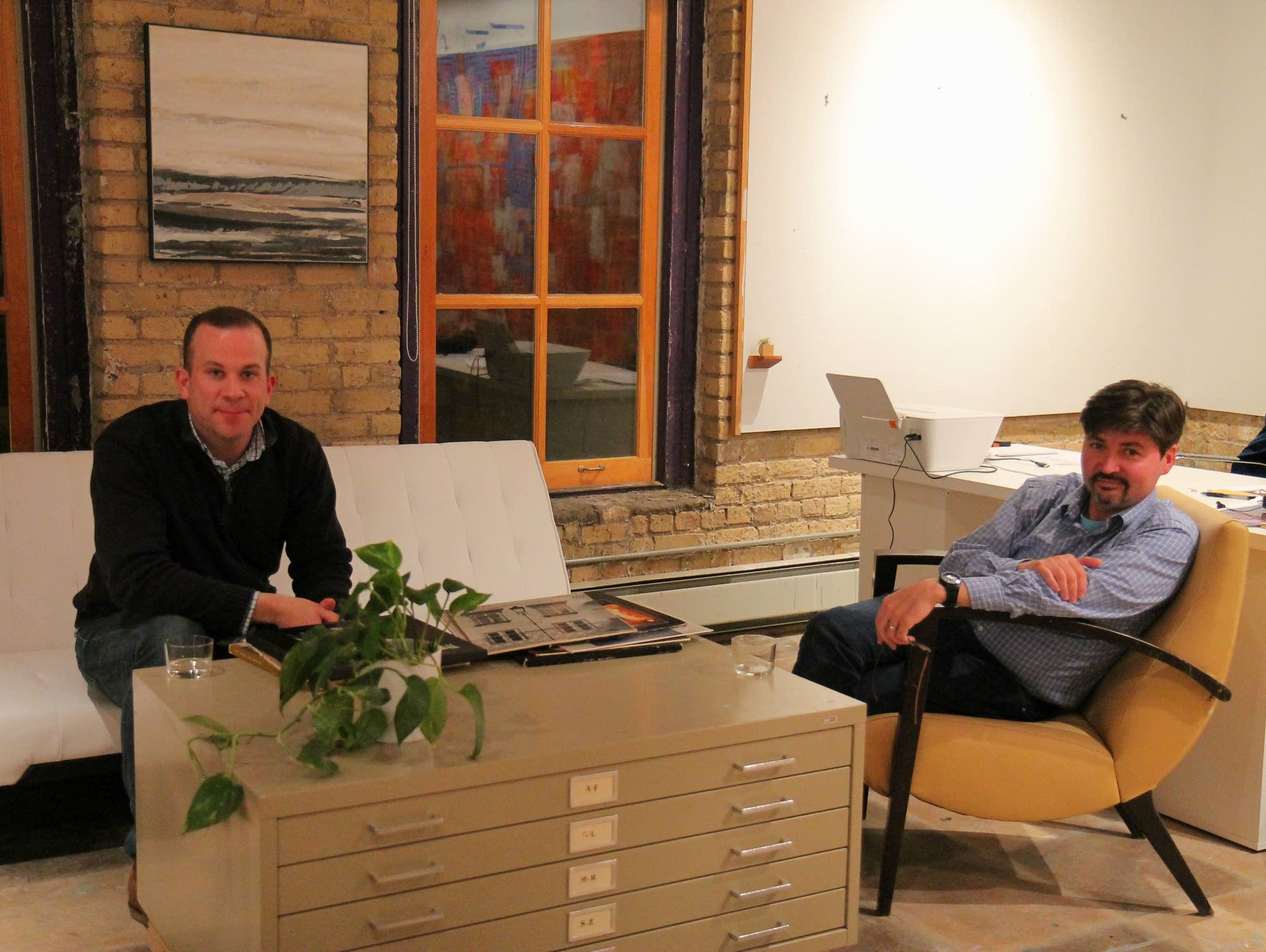 Jim O'Neill, left, and Michael Sutton chat about a vinyl collection.