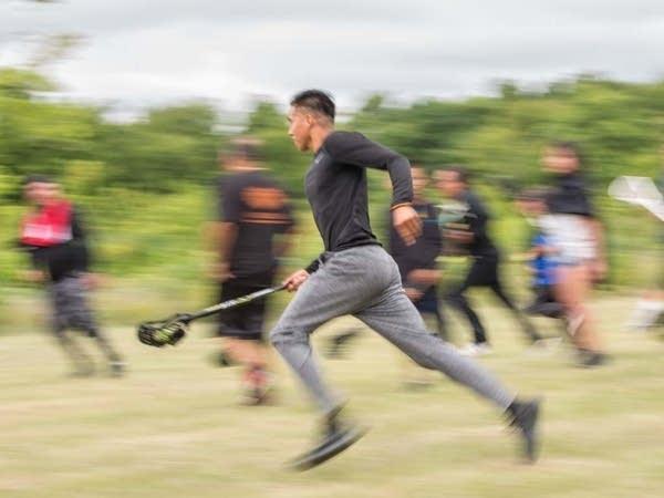 """Ozuia Cikala, """"Little Warrior,"""" runs across the field toward the goal."""
