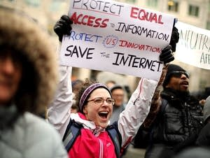 Protestors rally at  the FCC against the repeal of net neutrality rules.