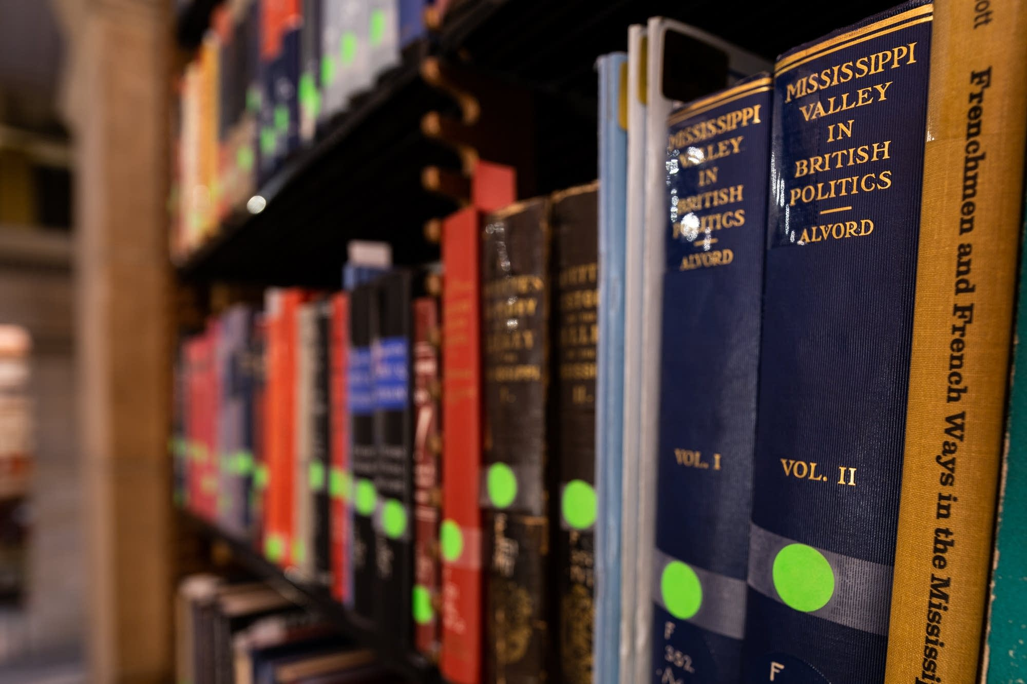 Historic books line the shelves of the James J. Hill Center in St. Paul.