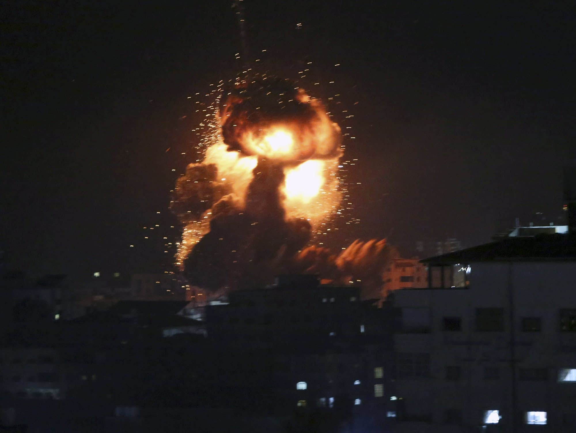 An explosion caused by Israeli airstrikes is seen in Gaza City.