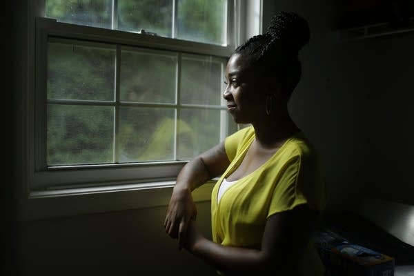 DeAnna Harris looks outside through a window.
