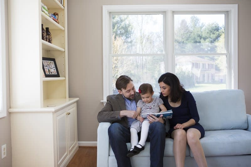 Travis and Sadiye Rieder read to their daughter