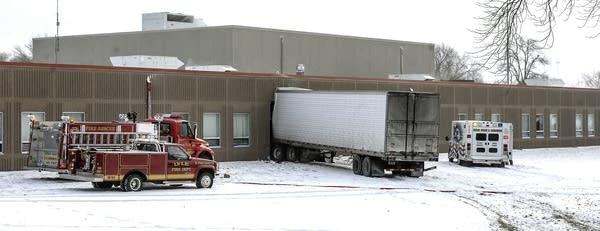 A semitrailer is embedded in the side of Lyle Public School