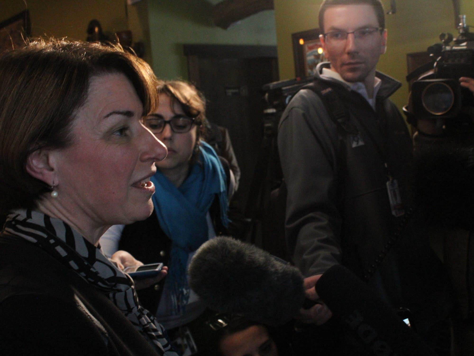 Amy Klobuchar speaks with journalists