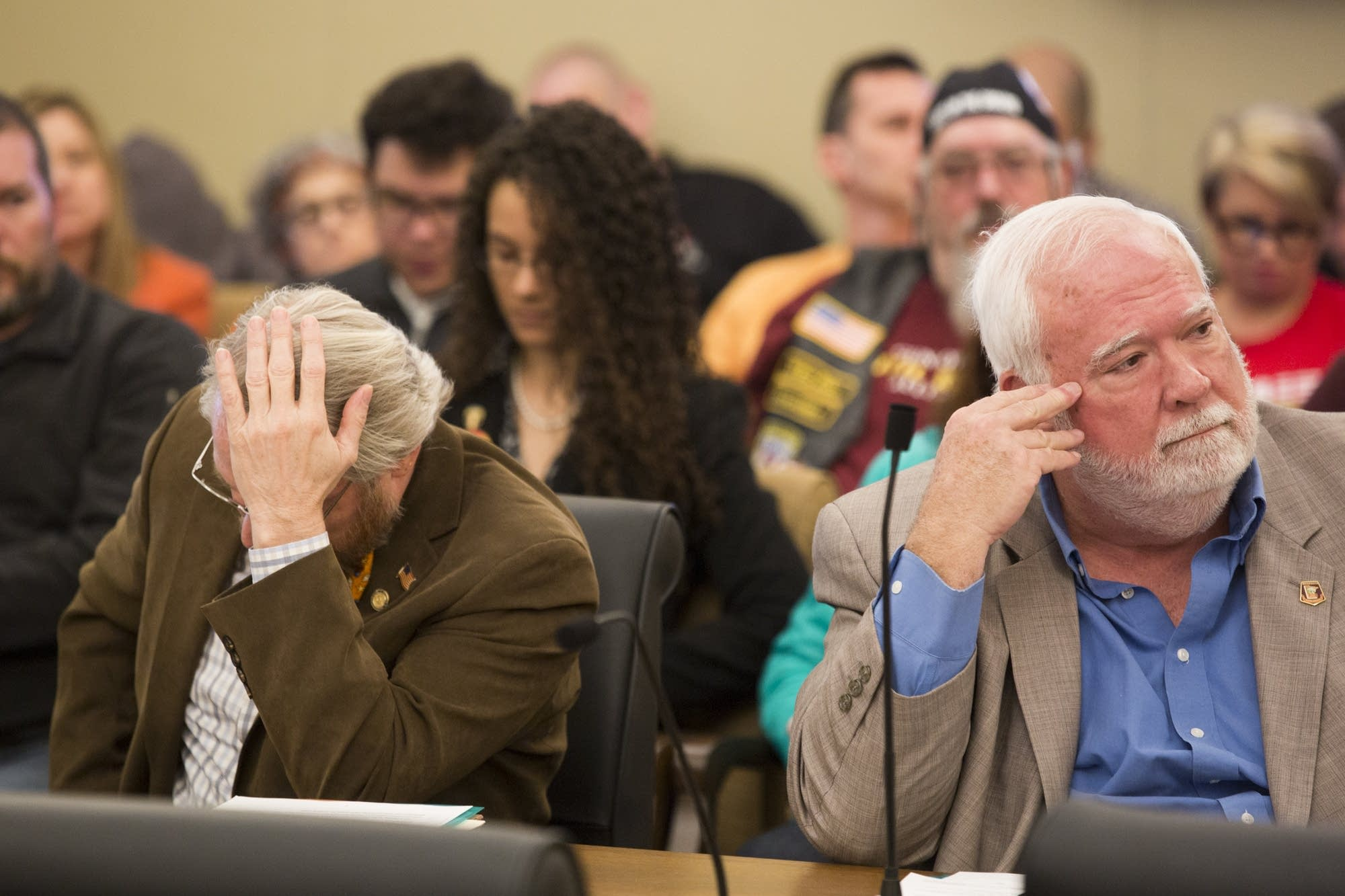 DFL Reps Raymond Dehn, left, and John Considine sit in frustration