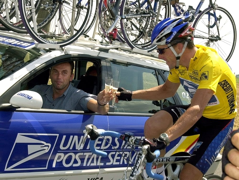 Johan Bruyneel, left, and Lance Armstrong