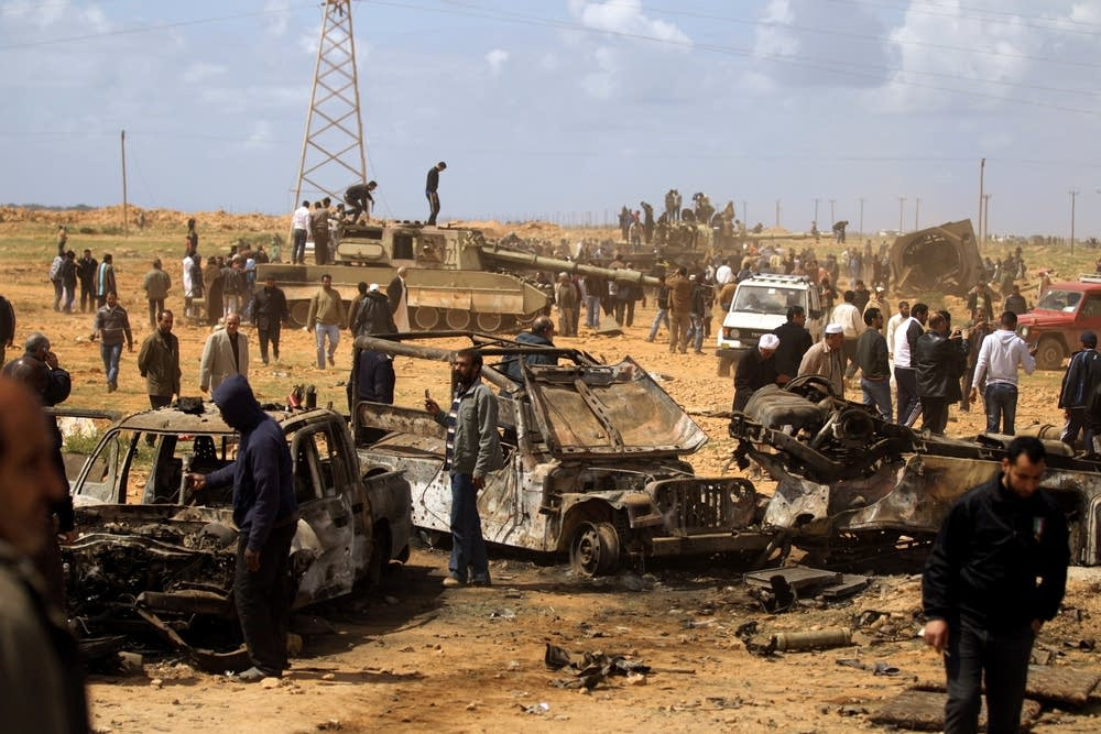 Libyan onlookers gather near wreckage
