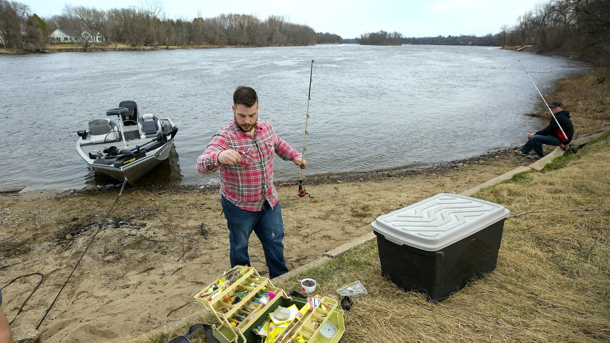 Thomas Struntz gets his gear ready along the Mississippi