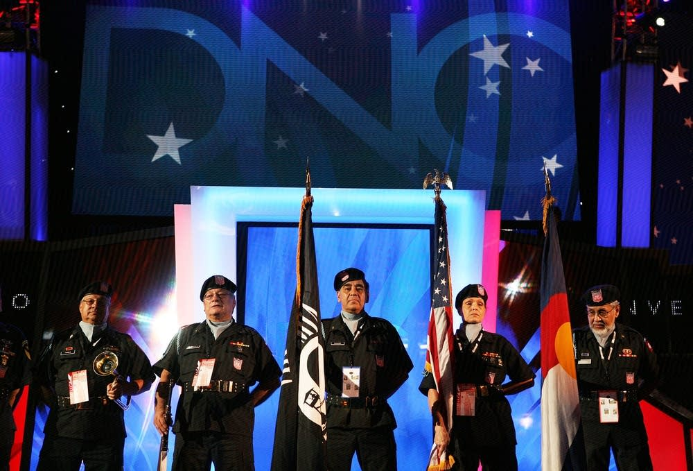 Members of the American GI Forum stand on stage