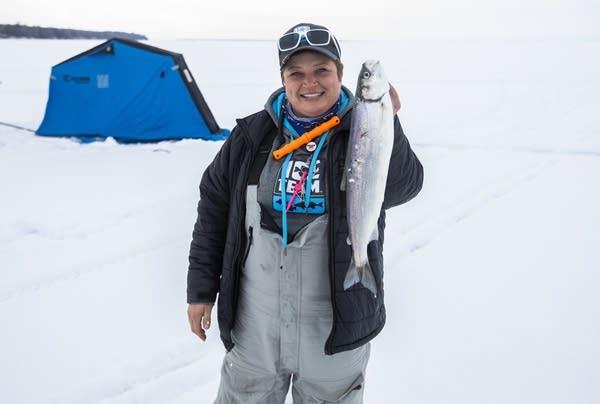 Rikki Pardun shows off a fish she caught.