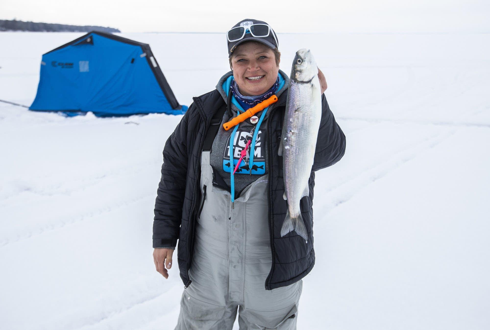 Rikki Pardun shows off a fish she caught