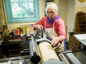 Betsy Bowen works in her studio.