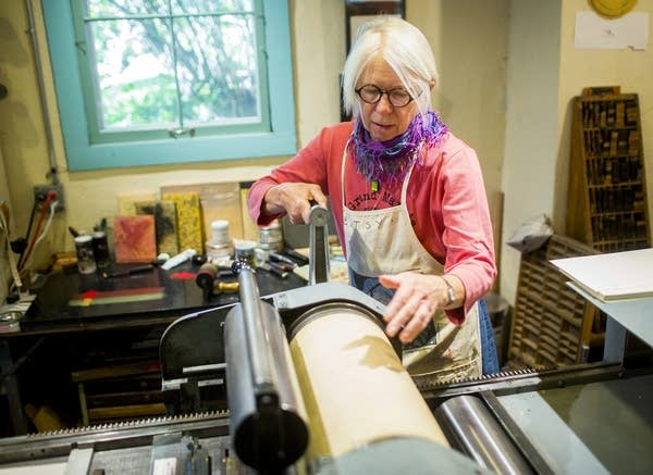Betsy Bowen works in her studio.