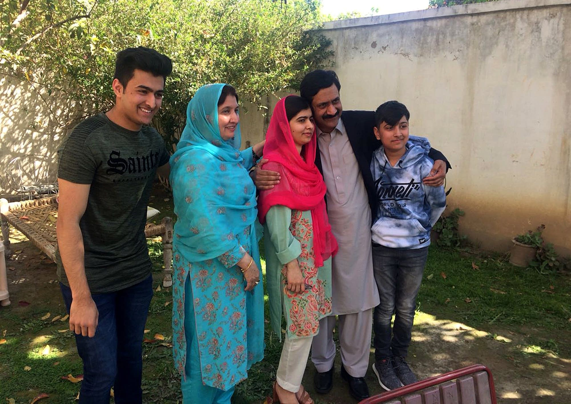 Malala Yousafzai poses for a photograph with her family members.