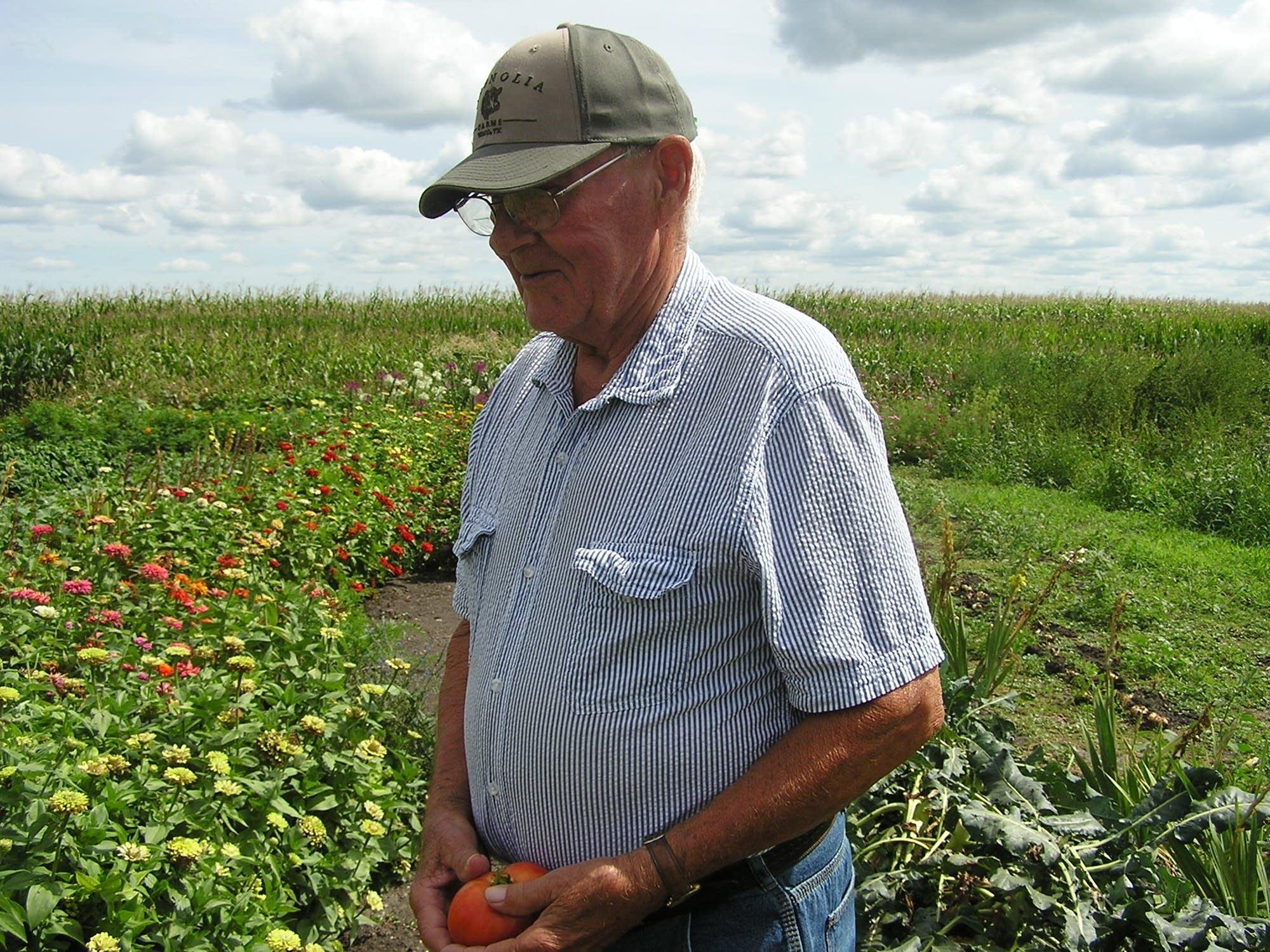Dennis Stelter stands in his garden