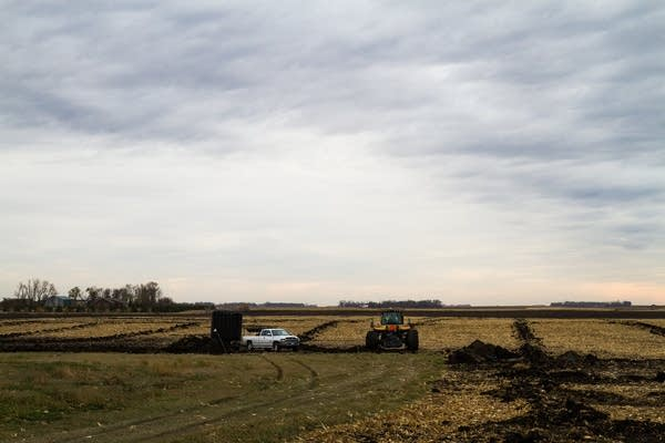Installing tile drainage system on a farm.