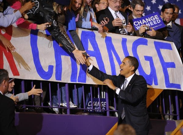 Barack Obama shakes hands with supporters
