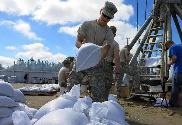 National Guard troops fill sandbags.