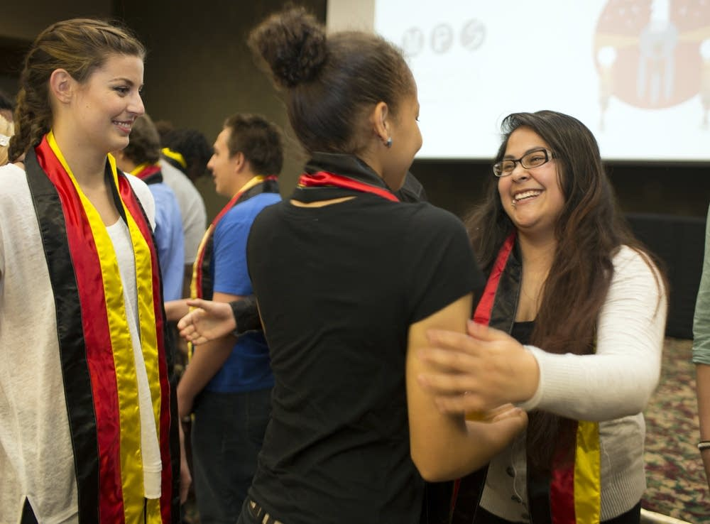 Students receive stoles to wear at graduation.