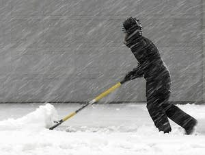 Michelle Armstrong shovels her parents' driveway in North Mankato.