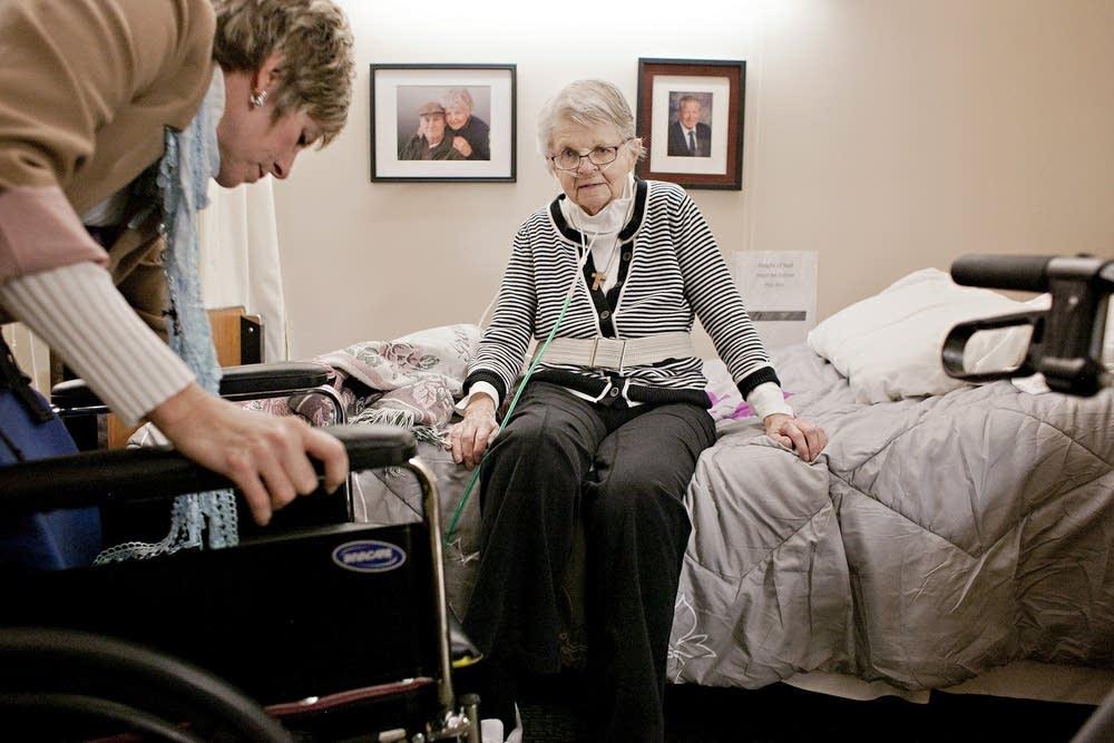 Faye Giese helps Jeanne Gunderson