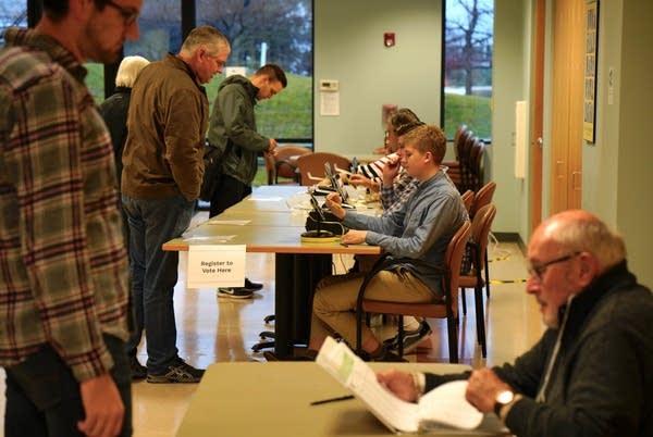 Student judge Mark Kivimaki checks in voters.