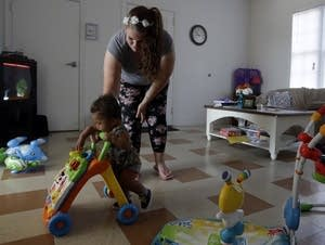 Shawnee Wilson plays with her son, Kingston in her apartment.