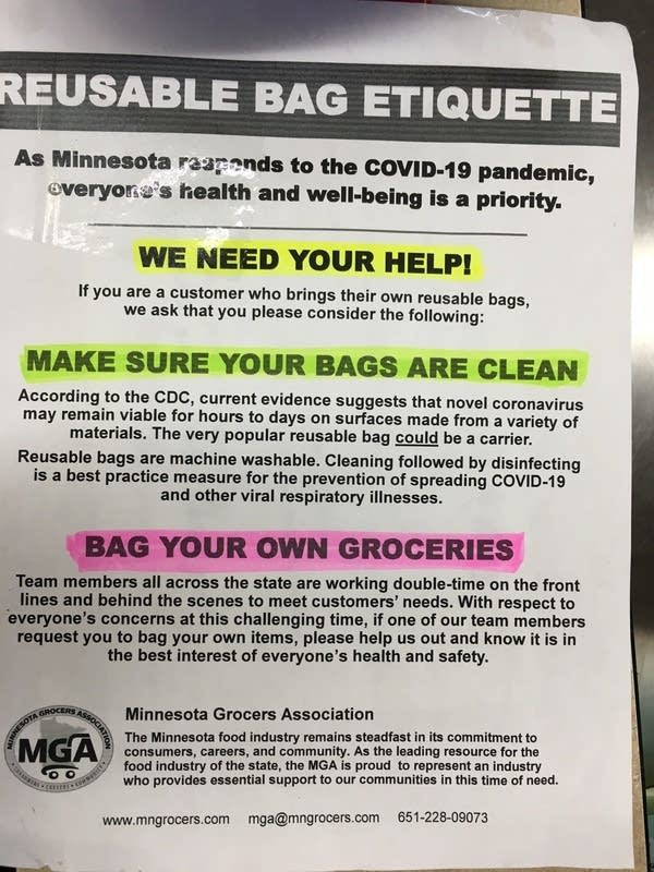 A sign at a grocery store about reusable bag etiquette.