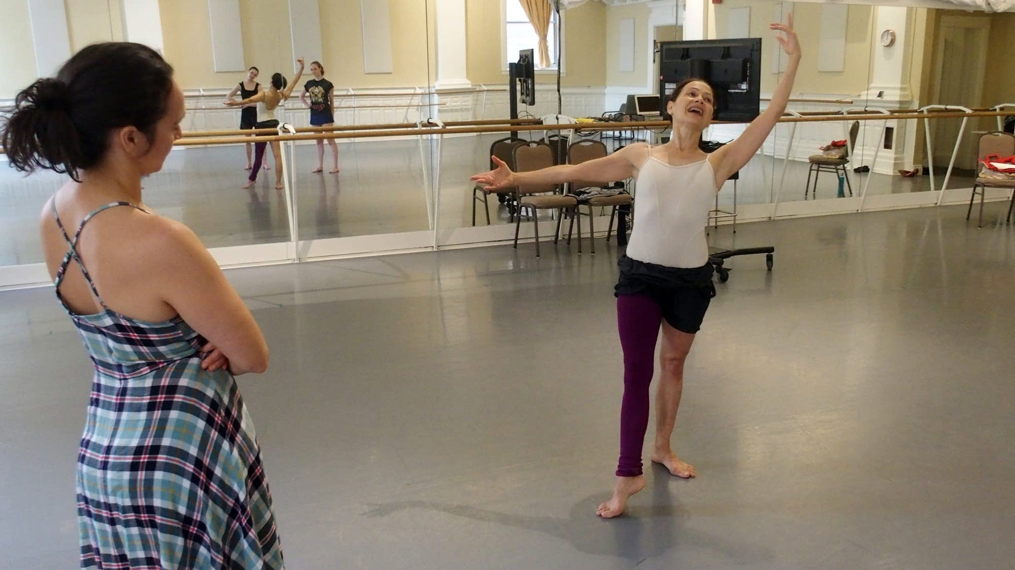 Sally Rousse demonstrates movements to a group of dancers.