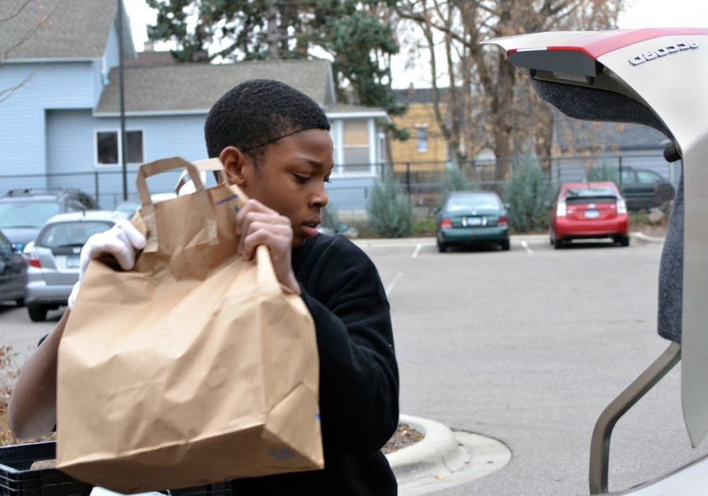 Hassan Jones loads meals for delivery.