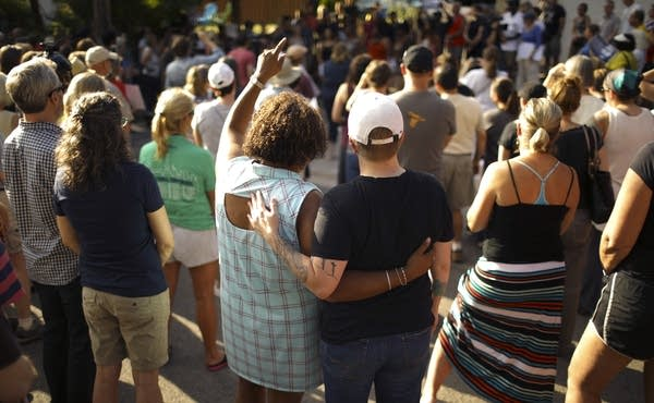 A crowd gathers to remember Justine Damond.