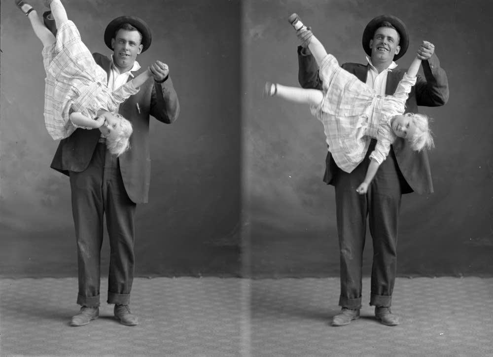 Father in a playful pose with his daughter.