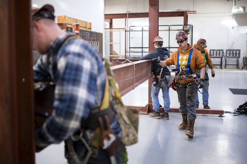 Garret Morgan, center, is training as an ironworker near Seattle.