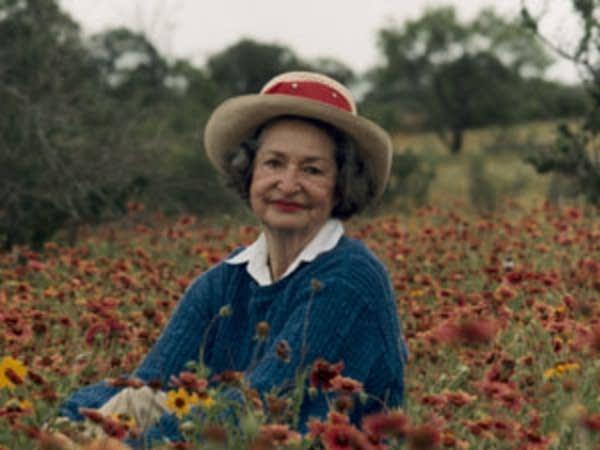 Lady Bird Johnson in a field of wildflowers