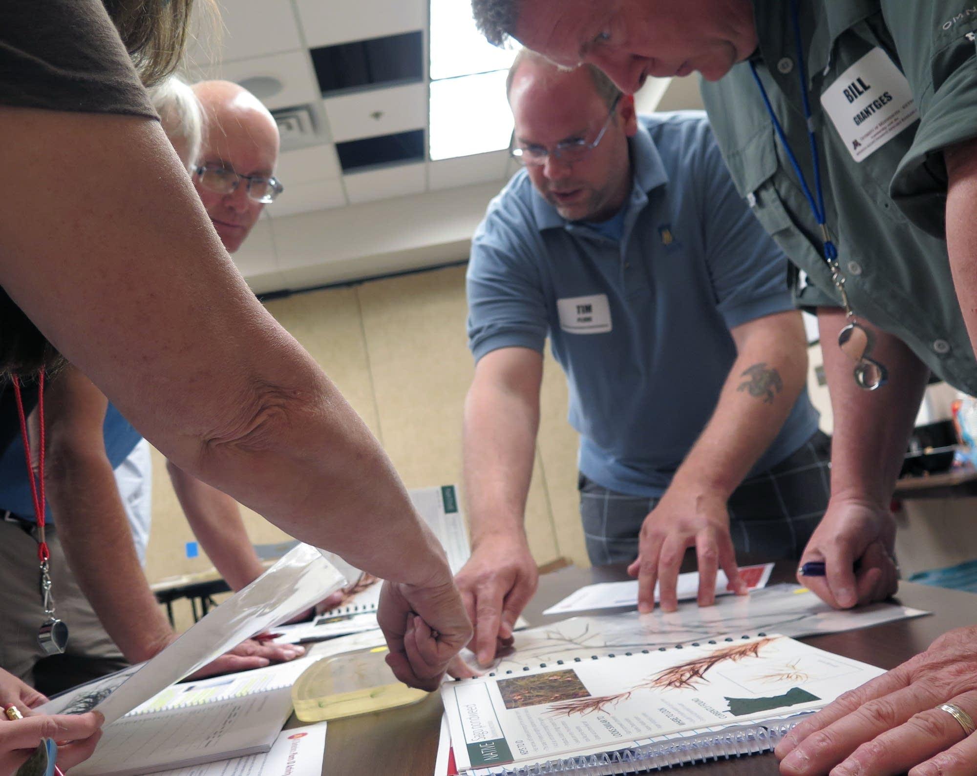 Participants in an AIS Detectors training program.