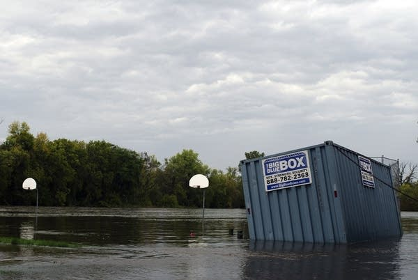 Cannon River floods basketball courts at Carleton.