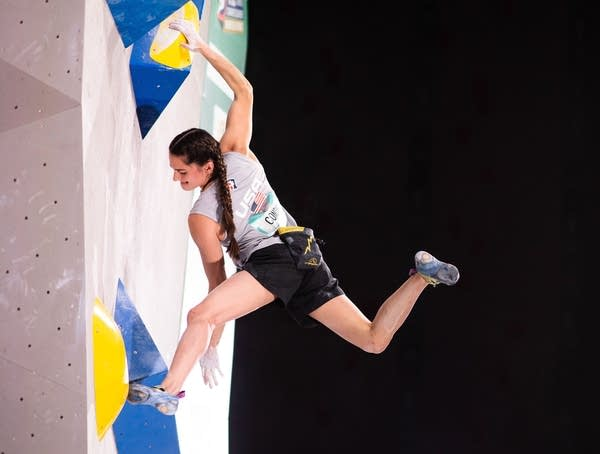A woman on a climbing wall