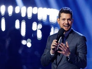 Singer Michael Buble speaks on stage