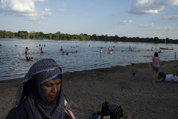 People swim at a beach.