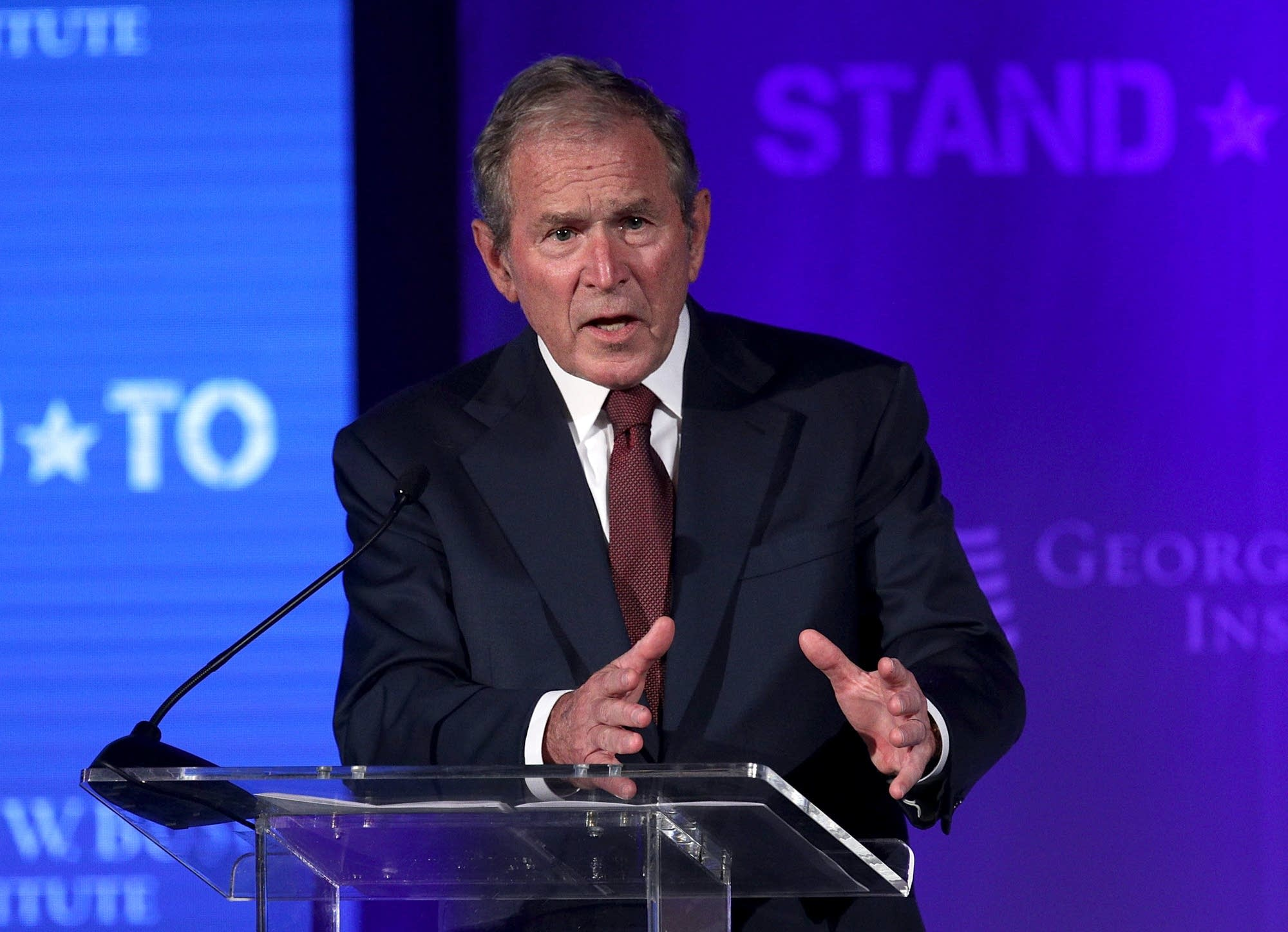 Former U.S. President George W. Bush speaks during a conference.