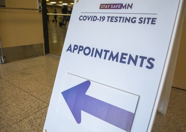 """A sign reads """"reads COVID-19 testing site appointments"""""""