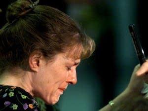 Columbine High School teacher Paula Reed is overcome with grief.