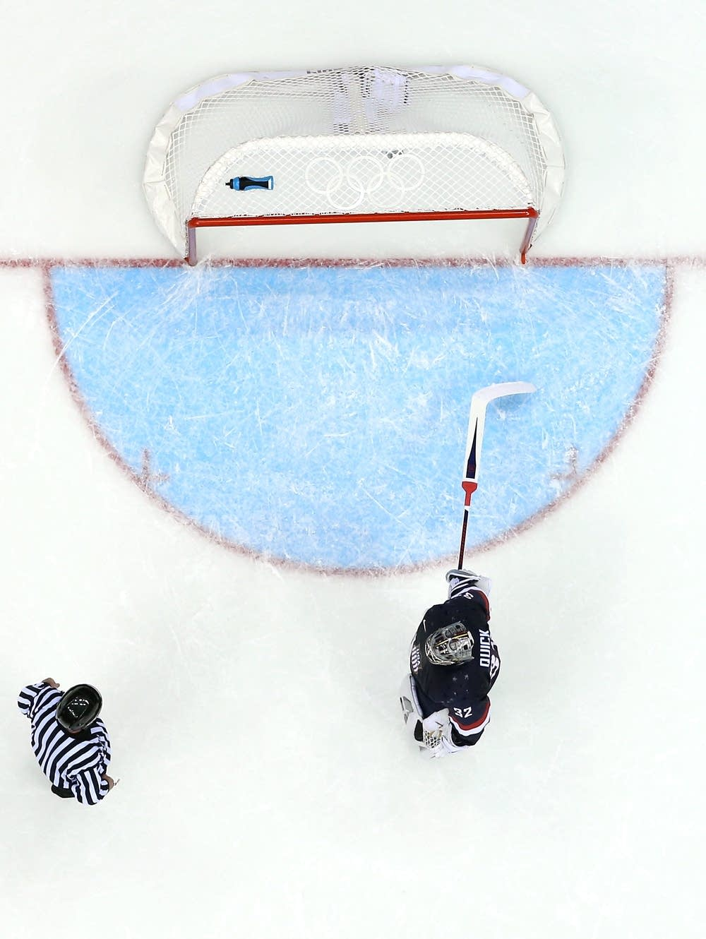 A referee checks the net